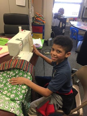 Keaton Doyle, a third grader at Compass Academy Charter School in Vineland, and his classmates showed support for cancer patients by making pillowcases and writing letters.