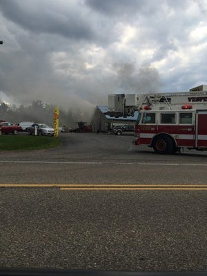 Firefighters on the scene of a fire at TJ's Auto and Collision Repair, 3277 State 73, Seneca 2 p.m. Thursday.