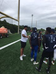 Cowboys' quarterback works with kids at charity camp in Princeton