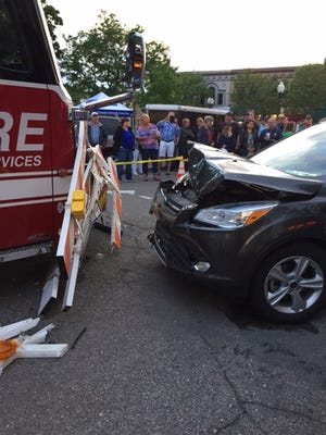 A woman drove her car through a road-closed barricade and crashed into a fire truck during opening night of Plymouth's Friday night concert series.