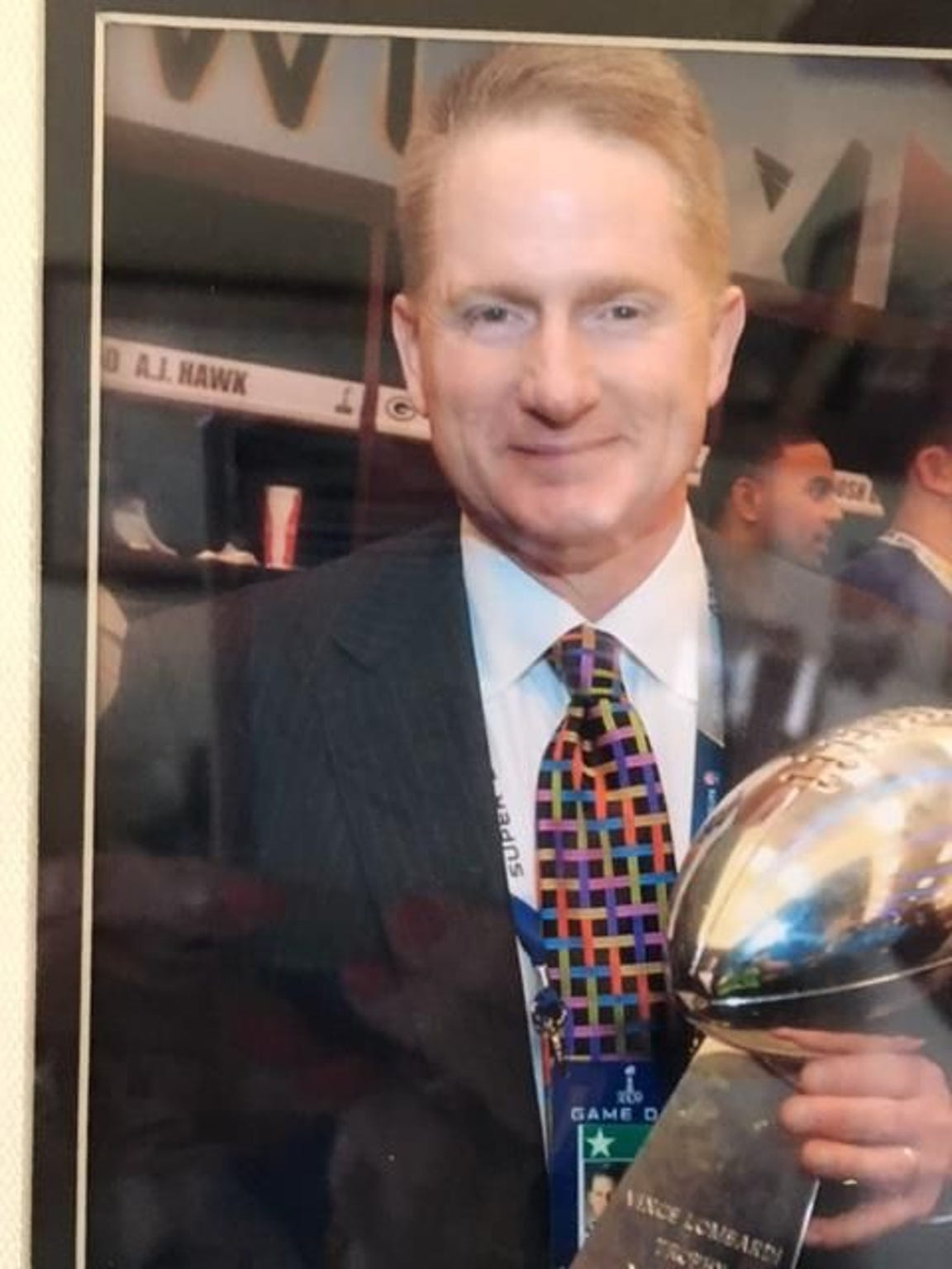 Russ Ball and the Vince Lombardi Trophy after the Packers