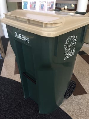 New 64-gallon recycling carts, like this one on display at the Canton Administration Building, are to start arriving Monday in Canton.