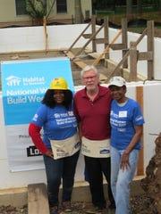 Tania-Sue Thomas (left) with Dennis Norby (center) of Lowe's of Hillsborough and Raritan Valley Habitat volunteer Josie Chisom.