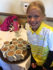 Mia McDowell bought a round of hot chocolate after her ace.