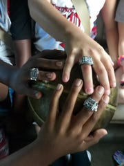 Way to go, Titans! The team shows off their championship rings.