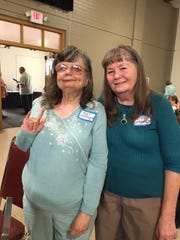 """Kathy Gransee, a former Camarillo State employee, invited her former patient Roxy Shifflet, left, to live with her family when the hospital closed in 1997. Shifflet, who is deaf and legally blind, is signing """"love."""""""