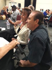 Switchboard operator Barbara Coffield and psych tech Marco Valdovinos catch up on old times at the Camarillo State Hospital employees reunion.