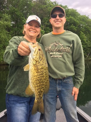 Darlene and Tal Janowitz behind a big smallmouth.
