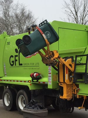 Canton's 64-gallon recycling carts are being picked up by trucks with mechanical arms.