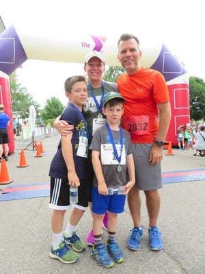 Parents Mary and Kory Gollan made the YMCA Father's Day Run part of their Father's Day celebration, running with 9-year-old son Gavin and 6-year -old son Karter.