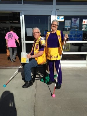 Hal and Sandy Griffin, of the Abilene Cactus Lions Club, collect funds for White Cane Day.