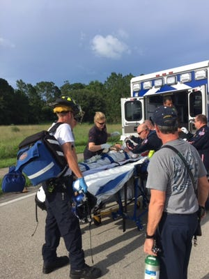 San Carlos Park Fire and Rescue District personnel help care for a 71-year-old woman who was bitten on the arm and leg Sunday at Shadow Wood Preserve.