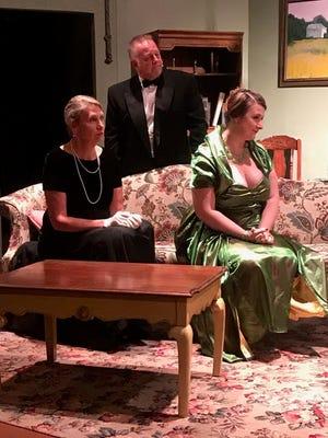 "Rebecca Wagstaff, Eric Blake and Jillian Von Gunten rehearse a scene from the Zanesville Community Theatre's production of ""Blithe Spirit."""