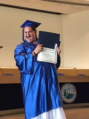 Kassie Spires of Port Huron holds up her certificate of completion from the YOU program. She hopes to eventually earn her Ph.D. in psychology.