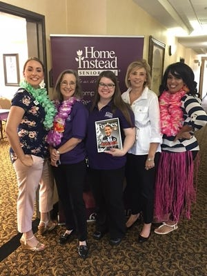 Home Instead Senior Care staff members Acacia Abshire, Donna Mazzarantani, Sara Moran, Wendy Lorenz and Diona Parker celebrate being ranked in the top 100 Forbes 2017 list of America's Best Large Employers.