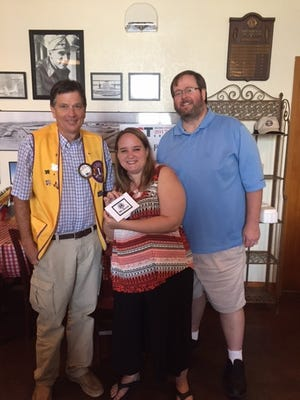 Abilene Founders Lions Club president Jeff Eckard (left) and member Tim Renfro (right) meet with Ginger Vinson, president of Abilene Community Theatre, who was the guest speaker at the club's July 20 meeting.