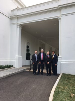 (right to left) John Bailey, owner of Bailey Coach in West Manchester Township, poses in front of the White House with fellow Pennsylvania small business owners Douglass Henry, Steve Rennekamp and Les Neilly. (Photo courtesy of Bailey)