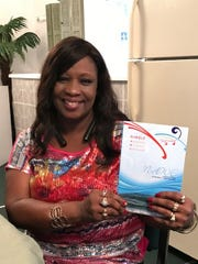 Lisa Rowell holding Nimble Anointed Words Empower (N-AWE)