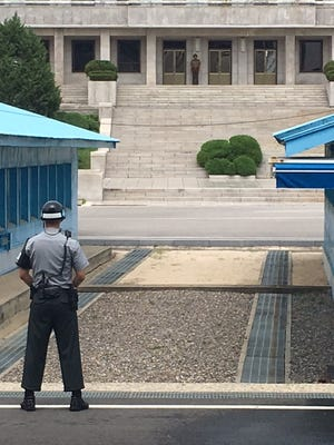 South Korea soldier keeps eye on his North Korean counterpart on the DMZ