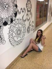 Lenape High School's Sara Burgos is shown working on