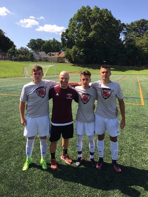The Clifton boys soccer team tri-captains (from left) Jake Padula, Michael Algieri and Tommy Miazga are pictured with Mustangs coach Stan Lembryk.