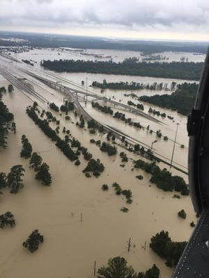 Citizen airmen with Patrick Air Force Base's 920th Rescue Wing started rescuing victims Tuesday who were trapped by Hurricane Harvey's widespread flooding.