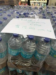 A case of water was seen being sold for $18 at the