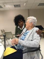 Loretta Hudson hugs Hazel Garlington at Hazel's birthday