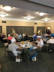 People eating and socializing at Hart Park Senior Center.