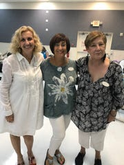 Attending the summer planning meeting were Carole Romano, Janie Copes and Nancy Rad.