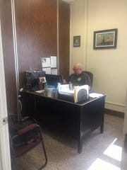 York County Coroner Chief Deputy Claude Stabley in his workspace – a Registered Nurse and former police lieutenant with YCPD.
