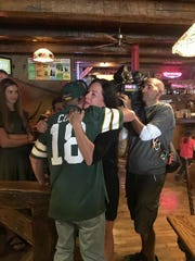 Chuck Wickert meets Marybeth Mielke of Hartland on Sunday, Oct. 8. Mielke was one of two women who saved his life 17 years ago at a Green Bay Packers game.