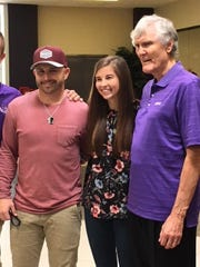 Olympic gold medal winner and Abilene Christian University alumnus Earl Young (right) introduces fellow ACU graduate Landa Dowdy to the recipient of her bone marrow transplant, Dustin Santoni.