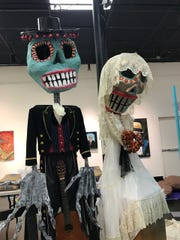 Dia de los Muertos puppets will be walking around the