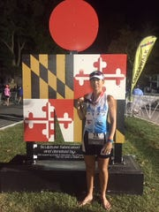 Cinnaminson's Joelle Kenney shows her medal after finishing Ironman Maryland on October 7 in Cambridge, Maryland. Kenney began competing in triathlons recently as a new challenge and to do something that was unique to her.