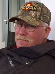 About three dozen neighbors gathered Wednesday to harvest the last crop of Van Brownlee, an Iowa farmer who died in May.