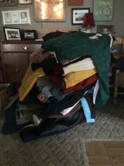A pile of donated clothes has sat in Connie Alexander's