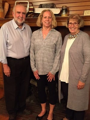 On Oct. 12, Glen and Barb Link presented a highly interesting, informative program — with  emphasis on education — about their recent trip to Cuba. Pictured with the Links is Vickie From, center, Alpha Xi president.