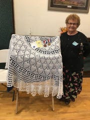 Anita Schuller of Kewaunee County Home and Community Education received two medallions for a crocheted table cloth she entered in the Cultural Arts competition at the HCE state conference in September.