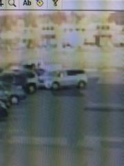 The suspect vehicle appears to be a grey 2015-2018 KIA Sedona minivan.