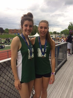 Senior Hannah Relovsky, left and junior Angelina Tarabokija helped the Kinnelon High School girls' cross country team qualify for a third-straight State Meet of Champions which will be held this weekend at Homdel Park.