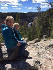 Donna Littlefield and Sandra Smith enjoy the view in Yellowstone National Park.