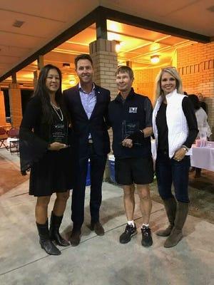 Long-time tennis volunteers Rita Dotson and Robert Isosaari were honored by USTA Florida at Monday's Futures Pro-Am/Mayor's reception.  From L to R : Rita Dotson, Mayor Ashton Hayward, Robert Isosaari, and local USTA Florida representative Tara Dominguez.