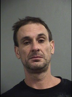 Shawn Murphy, 45, was arrested Sunday morning in connection with a fatal crash near Papa John's Cardinal Stadium.