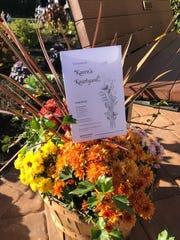 Flowers for the dedication of Karen's Kourtyard.
