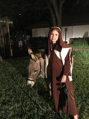 TIME FOR CHRISTMAS! - Shepherd Casey Davis is pictured at last year's Live Nativity, held at First Presbyterian Church of Tequesta. This year's event is slated for 6 p.m. Sunday, Dec. 17. Be sure to stay for cookies and hot cocoa!  A Dec. 24 Christmas Eve Candlelight Service, at 7 p.m., will also be at First Presbyterian Church, 482 Tequesta Drive, in Tequesta. The service includes hymns and the Chancel Choir. A traditional worship service will be at 10 a.m. with the Bell Choir.  For more information, visit www.tequestapres.org or call 561-746-5161 ext. 101.