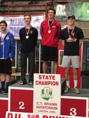 After finishing second last season, Indian Hill junior Noah Vigran (red jacket) won the state championship with a Division II record score. Indian Hill junior Noah Vigran stands on top of the podium as the Division II state diving champion Feb. 22 in Canton.