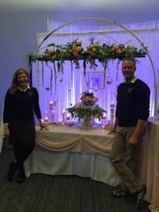 Theresa Menting and Travis Andrew represent Sweet N Easy Events at the annual Wedding Expo in Fond du Lac.