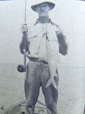 This is the only picture showing Capt. Bill Smith with his historic first-bonefish-on-fly catch at Islamorada in the Florida Keys in 1939.