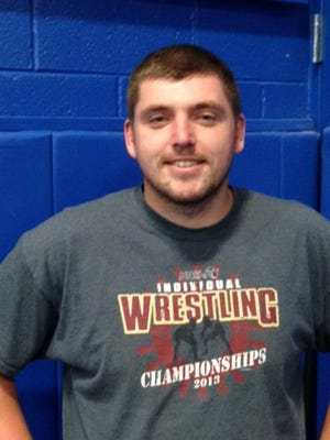 Salem wrestling coach Jeremy Henderson likes the way his team is competing early this season.